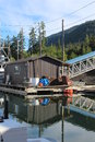 Float house in alaska harbor a small moored to a doc shoemaker on wrangell island Stock Image
