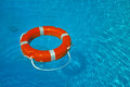 Float lifesaver on blue water Stock Images
