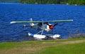 Float plane on beach on lake pleasant ny Stock Photos