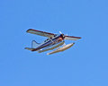 Float plane flying on a sunny day with blue sky Royalty Free Stock Images