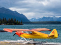 Float plane on lake small at a landing stage of a with mountains as background Royalty Free Stock Image