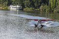 Float plane landing on Chena Rive Royalty Free Stock Photo