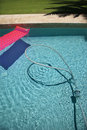 Float and vacuum hose in pool. Stock Photography