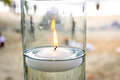 Floating candle in vase at beach Royalty Free Stock Photo