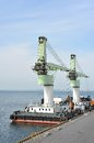Floating cargo crane over blue sky background Royalty Free Stock Photos