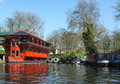 Floating chinese restaurant camden london a decorative boat on the regents canal in moored long boats and barges along the canal Stock Photography