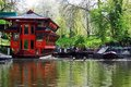 Floating chinese restaurant on regent s canal london red and narrowboats moored the Royalty Free Stock Photo