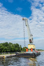 Floating crane on july in the port of gdansk the largest seaport in poland a major transportation hub in the central part of the Royalty Free Stock Photo