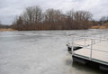 Floating docks frozen lake Stock Photo