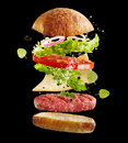 Floating fresh ingredients for a beef burger Royalty Free Stock Photo