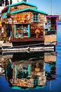 Floating home village brown houseboat fisherman s wharf victoria reflection inner harbor vancouver british columbia canada pacific Royalty Free Stock Photography