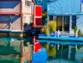 Floating home village red blue brown houseboats victoria canada fisherman s wharf reflection inner harbor vancouver british Royalty Free Stock Images