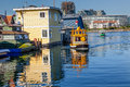 Floating home village water taxis victoria canada blue houseboats fisherman s wharf reflection inner harbor vancouver island Royalty Free Stock Photography