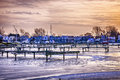 Floating homes at bluffers park marina sunset behind in toronto canada winter Royalty Free Stock Images
