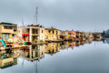 Floating homes and reflection Royalty Free Stock Photo