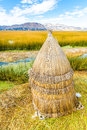 Floating islands on lake titicaca puno peru south america thatched home dense root that plants interweave form natural layer Royalty Free Stock Photography