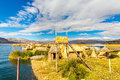 Floating islands on lake titicaca puno peru south america thatched home dense root that plants khili interweave form natural layer Stock Photo