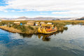 Floating islands on lake titicaca puno peru south america thatched home dense root that plants khili interweave form natural layer Royalty Free Stock Photography