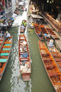 Floating market damnoen saduak thailand boats loaded with fruits and vegetables in ratchaburi Stock Image