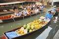 Floating market damnoen saduak thailand boats loaded with fruits and vegetables in ratchaburi Royalty Free Stock Photos