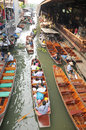 Floating market damnoen saduak thailand boats loaded with fruits and vegetables in ratchaburi Royalty Free Stock Photography