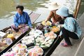 Floating market damnoen saduak thailand boats loaded with fruits and vegetables in ratchaburi Stock Photos