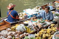 Floating market damnoen saduak thailand boats loaded with fruits and vegetables in ratchaburi Royalty Free Stock Photo