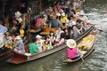 Floating market damnoen saduak thailand boats loaded with fruits and vegetables in ratchaburi Royalty Free Stock Image