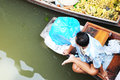 Floating market in damnoen saduak a vendor a boat the thailand Royalty Free Stock Photography