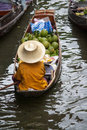 Floating market female trade in boating Stock Photos