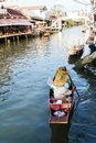 Floating market seller woman in the boat at thailand Stock Photo