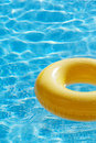 Floating ring on blue water swimpool with waves reflecting in the summer sun Stock Image