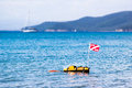 Floating scuba presence buoy in italian coast with yacht in the background Stock Images