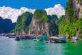Floating village near rock islands in Halong Bay, Vietnam Royalty Free Stock Photo