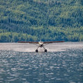 Floatplane landing on water in alaska Royalty Free Stock Image