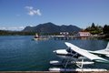 Floatplane parked in harbour in tofino british columbia canada on a sunny spring day a is the on s vancouver island the peaks of Royalty Free Stock Photos