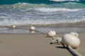 Floats on the sand a cord with white seaside Royalty Free Stock Image
