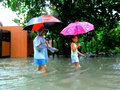 Flood caused by typhoon mario international name fung wong in the philippines on september residents of cainta rizal walk through Royalty Free Stock Images