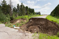 Flood damaged washed out road Royalty Free Stock Photo
