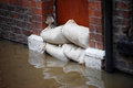 Flood defences sandbag barrier in doorway of flooded street in york Royalty Free Stock Photo