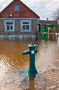 Flood flooding of urban river drowned house and street hydrant Stock Images