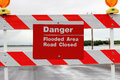 Flood road sign a warning of danger due to flooded Stock Photo