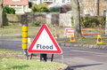 Flood sign basingstoke england february warning ahead of a road closed by waters in basingstoke rising ground water levels Royalty Free Stock Image