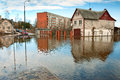 Flood the spilled the river flooded the road and city buildings Stock Image