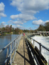 Flood water passing weir sluice gate river thames england Royalty Free Stock Photography