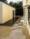 Flood water in yard a suburban brisbane Stock Photos
