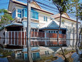 Flood waters overtake a house i in thailand Royalty Free Stock Images