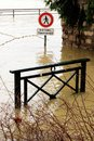 Flooded cross road warning sign Seine River banks damages Paris Royalty Free Stock Photo