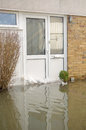 Flooded front door basingstoke england february flood waters reaching up to the of a house in hampshire after many days of Stock Photography