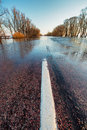Flooded rural road in spring Royalty Free Stock Images